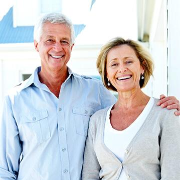 husband and wife seniors smiling