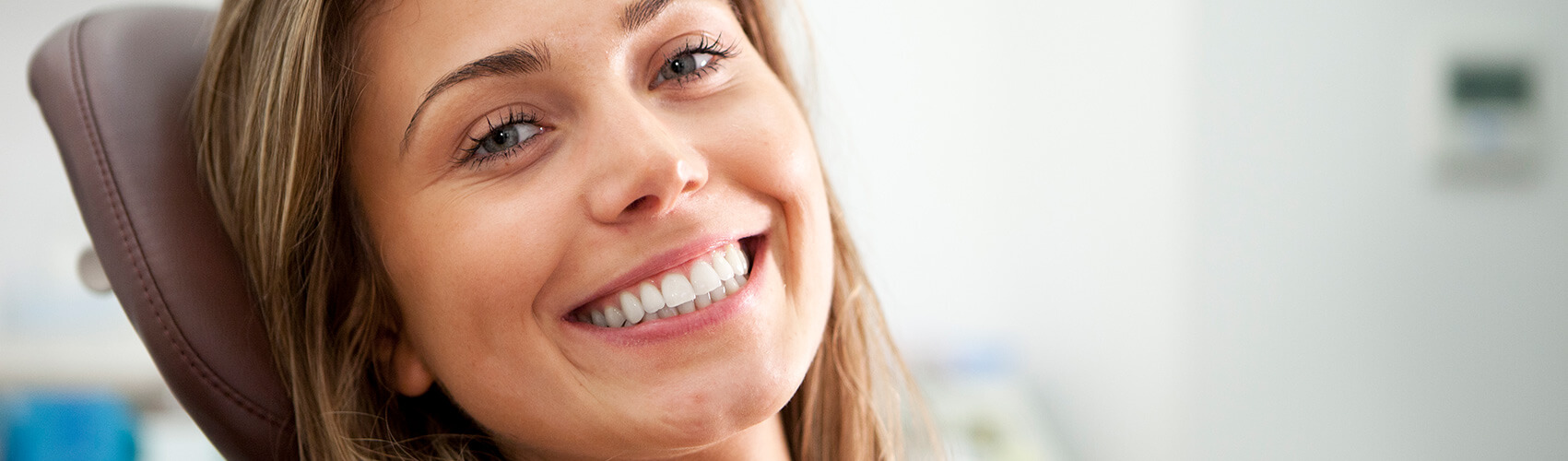 lady smiling in dental chair